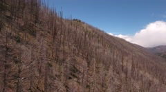 Aerial shot flying over mountain after wildfire Stock Footage