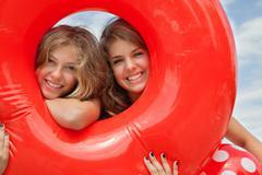 Women looking through buoyancy ring Stock Photos