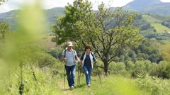 Senior couple on a hiking day in countryside - stock footage