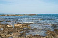 View of the Mediterranean sea from the coast in the early morning Stock Photos