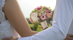Groom gives the bride a beautiful wedding bouquet Stock Footage