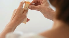 Closeup of woman applying hand cream Stock Footage