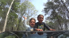 Boys Riding Through Sunroof of Car Stock Footage