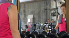 Young Fit Woman Lifting Dumbbells in Gym During Workout Stock Footage
