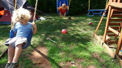 Little Boys Playing On Swing Set Stock Footage