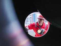 Worker inspects gas storage plant Stock Photos
