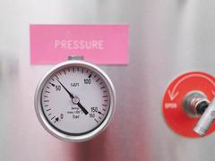 Pressure gauge at gas storage plant - stock photo