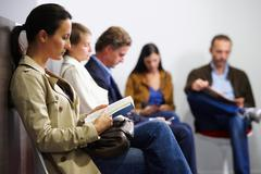 People sitting in waiting room - stock photo