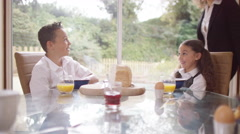 4K Happy family at breakfast time, mother gives her children a kiss - stock footage