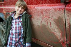 Boy with 4x4 landrover - stock photo