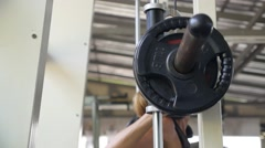 Sports Woman Weight Training on Smiths Machine in Gym Stock Footage