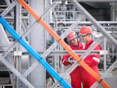 Workers inspect gas storage plant Stock Photos