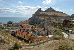 Scenic view towards Genoese fortress is in Sudak, Crimea, Russia. Stock Photos
