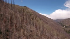 Aerial shot of flying over mountain after wildfire Stock Footage