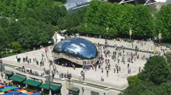 Tourists at the Chicago Bean Monument in Millennium Park Stock Footage