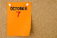 7 OCTOBER written on orange paper note - stock photo