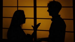 Couple fighting at home. Relations with quarrels. Silhouette. Close up - stock footage