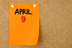 9 APRIL written on orange paper note - stock photo