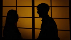 Girl gives the guy a slap in the face. Pushing hands. Silhouette. Close up Stock Footage