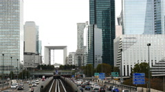 Time Lapse of Rail & Street Traffic at La Defense  - Paris France Stock Footage