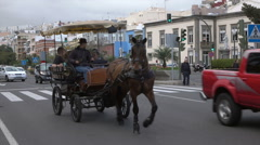 Las Palmas traffic on street, tourist horse and carriage, Canary Isles, Spain Stock Footage