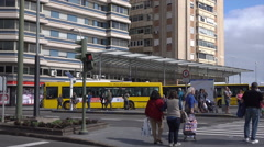 Las Palmas people cross road at bus station, Canary Isles, Spain Stock Footage