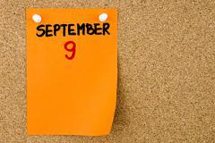 9 SEPTEMBER written on orange paper note - stock photo