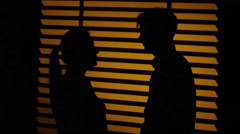 Man gives the woman a decorative heart. Silhouette. Close up Stock Footage