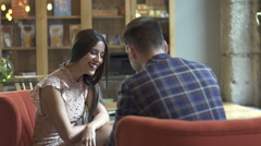A couple on an intimate dinner. Talk each other. - stock footage