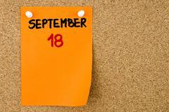 18 SEPTEMBER written on orange paper note - stock photo