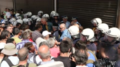 Crowd of people and police in uniforms in Athens center Stock Footage