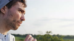 4K Young man looks to the horizon pensively Stock Footage