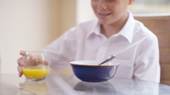 4K Portrait of little boy at the breakfast table, his father gives him a kiss Stock Footage