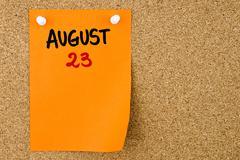 23 AUGUST written on orange paper note - stock photo