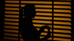 Girl quickly turns the log sheets. Silhouette. Close up - stock footage