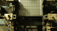 Sheet of metal on press Stock Footage