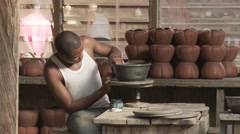 Cameroon potery, medium shoot, Potter with pots. Stock Footage