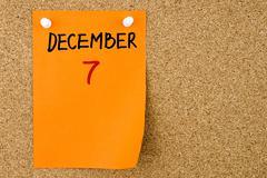 7 DECEMBER written on orange paper note - stock photo