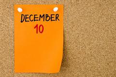 10 DECEMBER written on orange paper note - stock photo