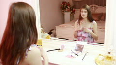 Girl takes a pearl necklace. She is sitting near a mirror. chic luxury interior Stock Footage
