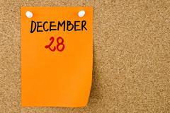 28 DECEMBER written on orange paper note - stock photo