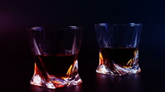 Man's drinking whiskey on black background - stock footage