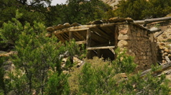 Zoom in-Old pioneer stone and wood structure in ruins-HD Stock Footage