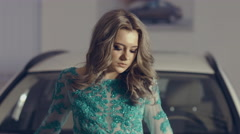 Beautiful model in evening dress is photographed on a background of  the luxury Stock Footage