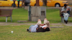 Young couple cuddling in the park - stock footage