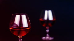 Bottle brandy and glass from brandy on black background Stock Footage