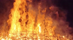 Slow motion shot of man burning dry branches on the bonfire - stock footage