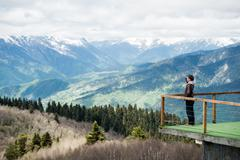 Relaxed man observing majestic mountain with a hand over his eyes Stock Photos