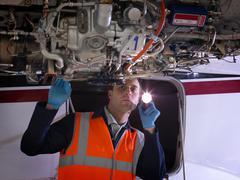 Engineer inspects jet engine Kuvituskuvat