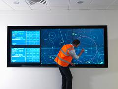 Air traffic controller with simulation - stock photo